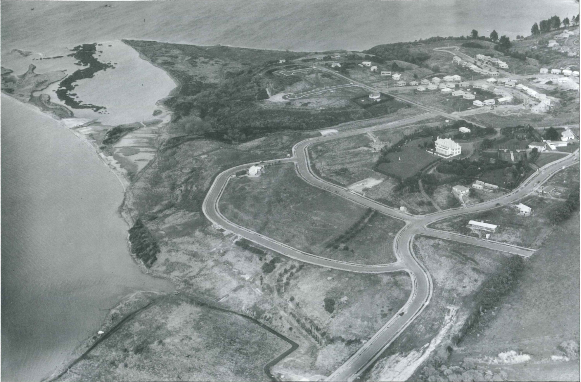 Beverley Hills subdivision in foreground, Calder and California Places in centre background, Sandspit to the left (1956. Air Logistics Inc.  Whites Aviation)